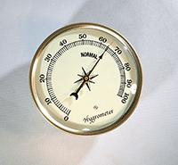 Gold bezel ivory hygrometer
