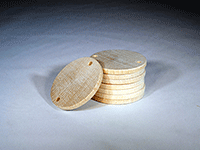 Wooden disc with two drilled holes