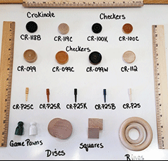 wooden game pieces and crokinole checkers